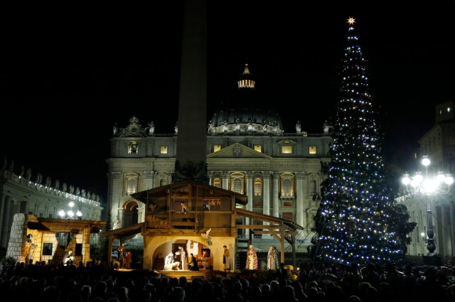 The Christmas tree and Nativity scene decorate St. Peter's Square during a lighting ceremony at the Vatican Dec. 18. (CNS/Paul Haring)