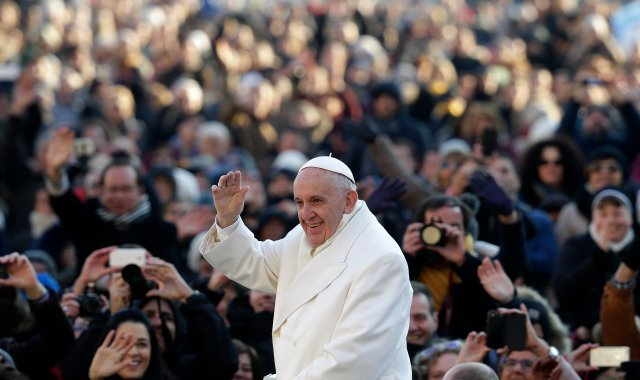 Pope Francis waves as he arrives to lead his weekly audience in St. Peter's Square at the Vatican Dec. 30. (CNS photo/Max Rossi, Reuters)