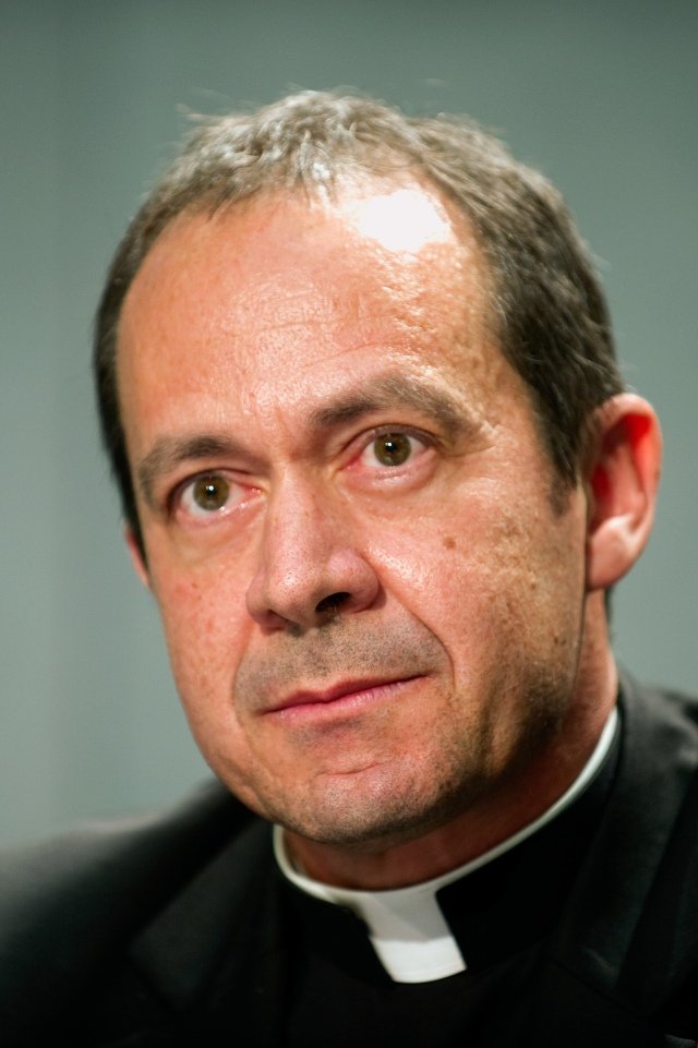 Msgr. Antoine Camilleri, undersecretary for relations with states and head of the Vatican delegation to the Moneyval plenary, is pictured during a 2013 news conference in Rome. (CNS photo/Giancarlo Giuliani, Catholic Press Photo)