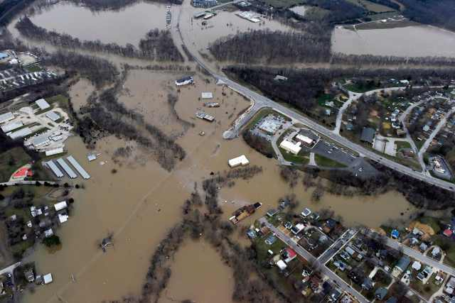 Submerged roads and houses are seen Dec. 28 after several days of heavy rain led to flooding in Union, Mo. (CNS photo/Kate Munsch, Reuters)