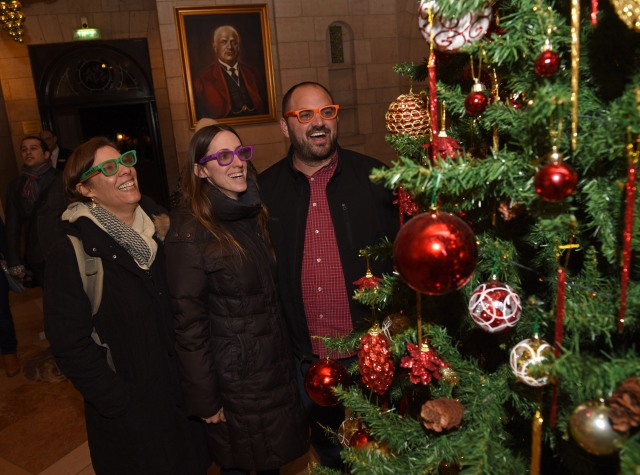Galit Oren, Tali Khanin, and Zohar Kaplan wear special glasses that make the lights multiply on the Christmas tree in the lobby of the YMCA in West Jerusalem Christmas Eve. They were part of a group of secular rabbinical students who had come to experience Christmas in Jerusalem. (CNS photo/Debbie Hill)