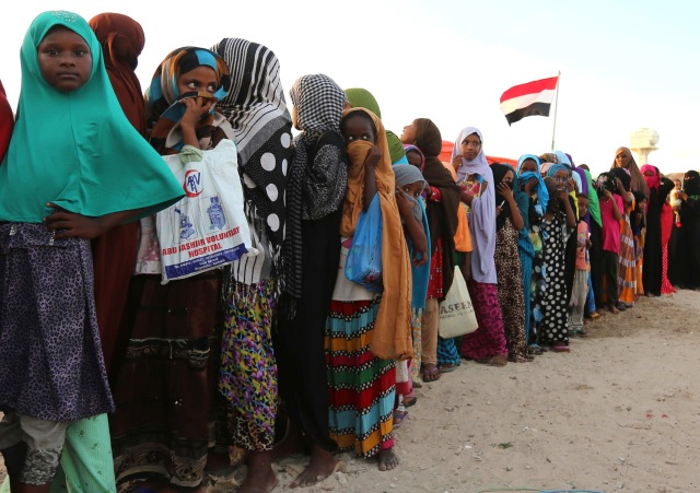 Yemeni refugees wait in line for food rations Dec. 16 at a makeshift camp in Somalia's capital, Mogadishu. (CNS photo/Feisal Omar, Reuters)