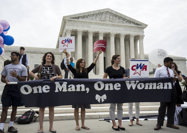 Supporters of traditional marriage rally in front of the U.S. Supreme Court in Washington. (CNS/Reuters)