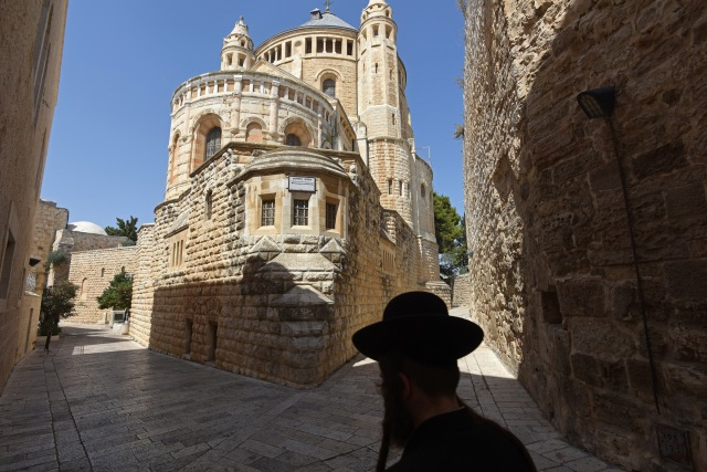 An Ultra-Orthodox Jew walks past the Dormition Abbey on Mt. Zion in Jerusalem last year. (CNS/Debbie Hill)