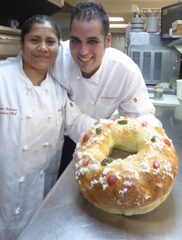 Margarita Castillo, chief pastry chef at Washington's Taberna del Alabardero, and Javier Romero, executive chef, display a finished roscon de reyes, a cake traditionally savored during the Epiphany in Mexico and Spain. (CNS/Rhina Guidos)