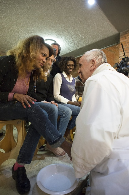 Pope Francis washes the foot of a female inmate during the Holy Thursday Mass at Rebibbia prison in Rome last year. (CNS/L'Osservatore Romano)
