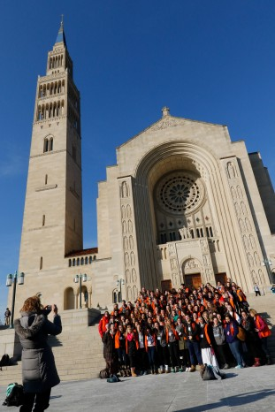 Students and staff from Notre Dame High School in Peoria, Ill., pose on the steps of the Basilica of the National Shrine of the Immaculate Conception in Washington Jan. 21 after arriving for the opening Mass of the National Prayer Vigil for Life. Pro-life advocates began arriving in Washington to participate in the annual March for Life Jan. 22. (CNS/Gregory A. Shemitz)