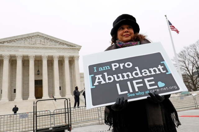 Pro-life advocate Teresa Cathcart of Spring Branch, Texas, stands in front of the Supreme Court building during the March for Life in Washington. (CNS/Gregory A. Shemitz)