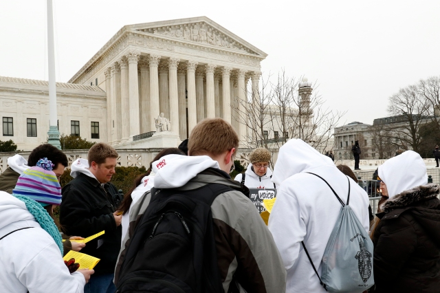 Members of the campus ministries of the Diocese of Ogdensburg, N.Y., pray in front of the Supreme Court building during the March for Life in Washington Jan. 22, the 43rd anniversary of the Supreme Court's Roe v. Wade decision legalizing abortion. (CNS/Gregory A. Shemitz)