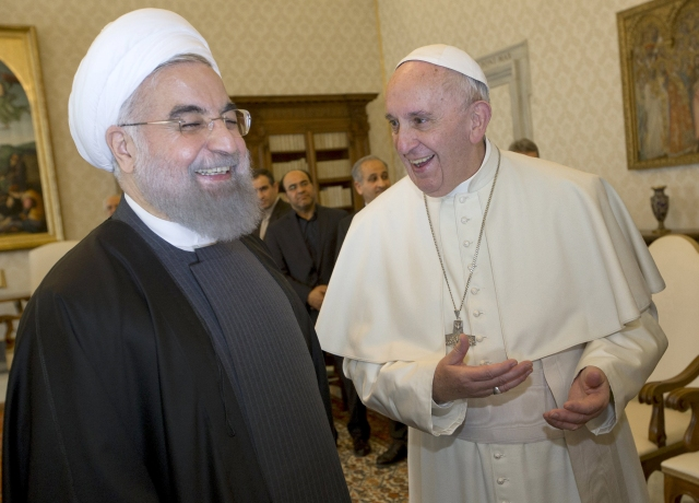 Pope Francis shares a light moment with Iranian President Hassan Rouhani during a private meeting at the Vatican Jan. 26. (CNS/pool via Reuters)