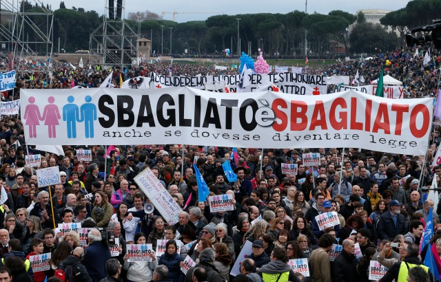 "People attend the Family Day rally at the Circus Maximus in Rome Jan. 30. The sign in Italian says: ""Wrong is wrong even if it becomes law."" (CNS/Paul Haring)"