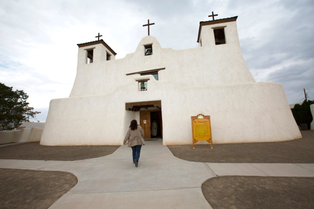 A woman arrives for Mass at St. Augustine Mission in the Pueblo of Isleta in New Mexico. (CNS/Nancy Wiechec)
