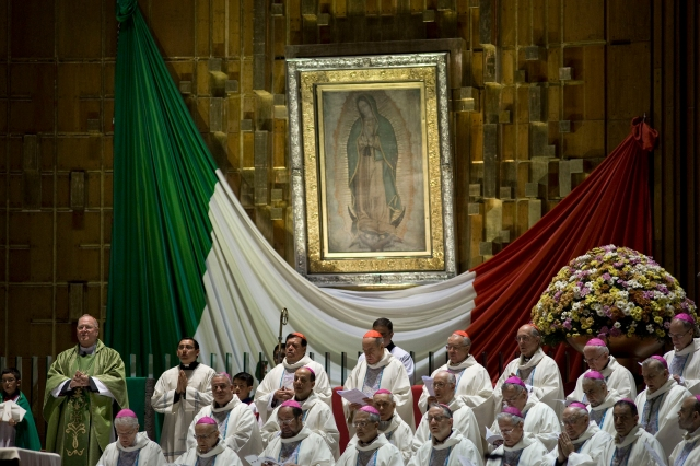 New York Cardinal Timothy M. Dolan, left, celebrates Mass in 2013 alongside other prelates at the Basilica of Our Lady of Guadalupe in Mexico City. (CNS/David Maung)