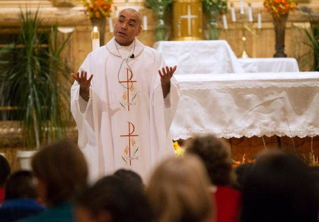 Father Adrian Vazquez talks to his parishioners during an evening Communion service at Good Shepherd Catholic Church in Driggs, Idaho, one of four faith communities he is in charge of. (CNS/Chaz Muth)