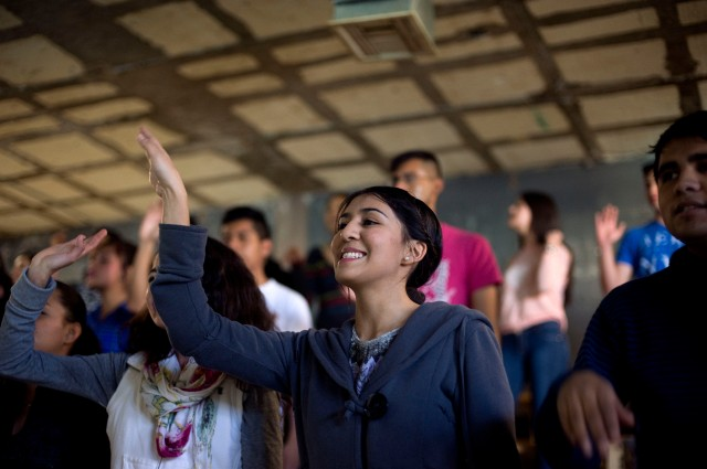 Diana Vega Flores, 18, sings during a youth ministry program at Corpus Christi parish in Ciudad Juarez, Mexico. (CNS/David Maung)