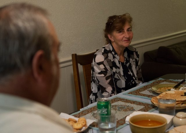 Iraqi refugee Aida Sarkisian prepares to eat dinner with her family at their apartment in Raleigh, N.C. (CNS/Chaz Muth)