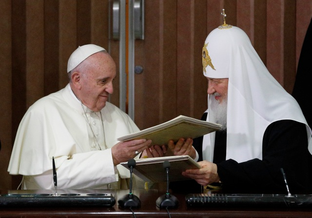 Pope Francis and Russian Orthodox Patriarch Kirill of Moscow exchange copies after signing a joint declaration during a meeting at Jose Marti International Airport in Havana Feb. 12. (CNS/Paul Haring)