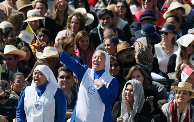 Nuns cheer as they wait for Pope Francis' arrival to celebrate Mass in Ecatepec near Mexico City Feb. 14. (CNS/Paul Haring)