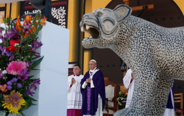 A panther decorates the altar as Pope Francis celebrates Mass with the indigenous community from Chiapas in San Cristobal de Las Casas, Mexico, Feb. 15. (CNS/Paul Haring)