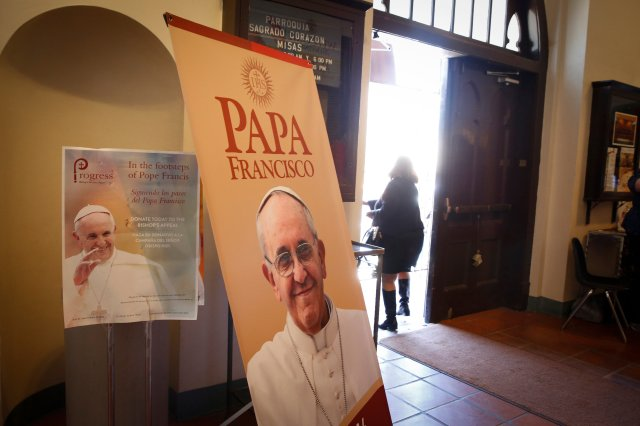 Images of Pope Francis are displayed in the vestibule of Sacred Heart Parish in the Segundo Barrio of El Paso, Texas. During Pope Francis' visit to Mexico, members of Sacred Heart prayed twice each day for his intentions of mercy and peace and for his safety. The church is located a few blocks from the border with Mexico. (CNS/Nancy Wiechec)