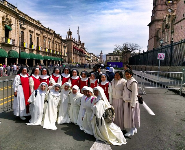 Women religious pose for a photo outside the Cathedral of Morelia in the state of Michoacan, Mexico, Feb. 15. Pope Francis will visit the cathedral Feb. 16 prior to his meeting with youth. (CNS/Junno Arocho Estevez)