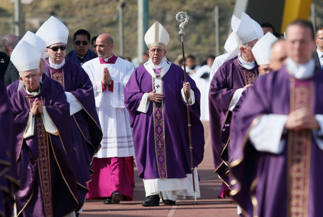Pope Francis arrives in procession to celebrate Mass with priests and religious at a stadium in Morelia, Mexico, Feb. 16. (CNS/Paul Haring)