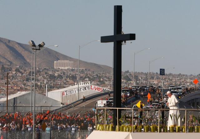 Pope Francis prays at a cross on the border with El Paso, Texas, before celebrating Mass at the fairgrounds in Ciudad Juarez, Mexico, Feb. 17. (CNS/Paul Haring)