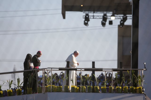 Pope Francis is seen from the U.S. side of the Rio Grande as he prays at a border overlook before celebrating Mass Feb. 17 in Ciudad Juarez, Mexico. (CNS/Nancy Wiechec)
