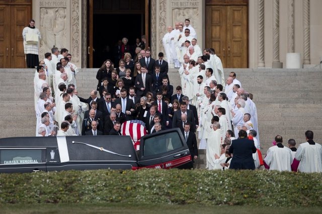 Family members follow the casket of the late Supreme Court Justice Antonin Scalia to a hearse waiting outside the Basilica of the National Shrine of the Immaculate Conception in Washington after his Feb. 20 funeral Mass. (CNS/Tyler Orsburn)