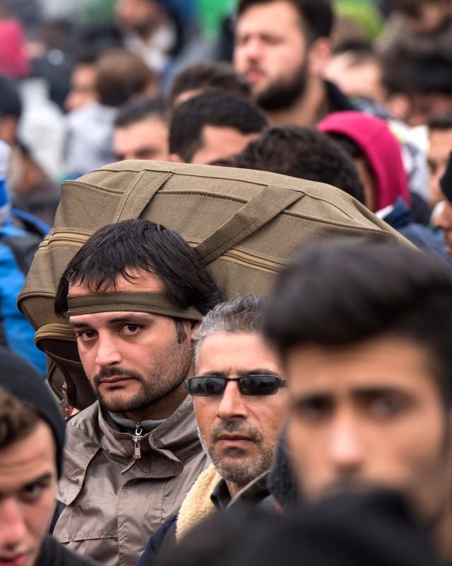 Refugees and migrants from Iraq and Syria wait for permission to leave a registration and transit camp near Gevgelija, Macedonia, Feb. 24. The Knights of Columbus, based in New Haven, Conn., and the Washington-based group In Defense of Christians have mounted a petition campaign asking Secretary of State John Kerry to make a decision on whether to make a declaration of genocide in the Middle East. (CNS photo/Georgi Licovski, EPA)