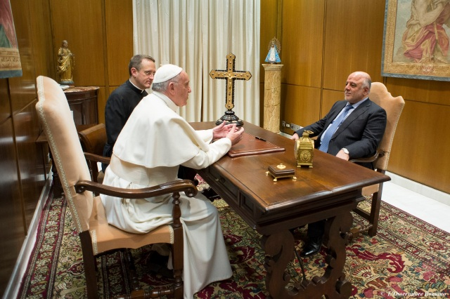 Pope Francis talks with Iraqi Prime Minister Haider al-Abadi during a Feb. 10 meeting at the Vatican. (CNS photo/L'Osservatore Romano)