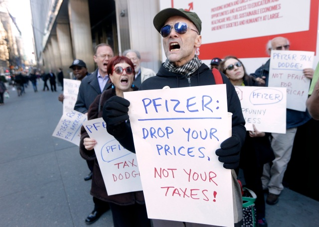 Demonstrators protest medicine prices outside Pfizer headquarters in New York City in this Dec. 4, 2015, file photo. (CNS photo/Andrew Gombert, EPA)