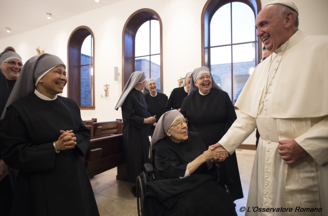 Pope Francis greets Sister Marie Mathilde, 102, during his unannounced visit to the Little Sisters of the Poor residence in Washington Sept. 23. (CNS/L'Osservatore Romano)