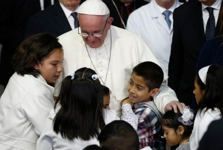 Pope Francis embraces children during a visit to a children's hospital in Mexico City Feb. 14. A Pennsylvania bishop pledged transparency in dealing with reports of abuse of children in his diocese. (CNS/Paul Haring)