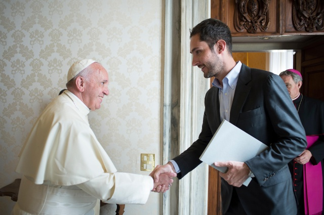 Pope Francis meets Kevin Systrom, co-founder and CEO of Instagram, during a private audience at the Vatican Feb. 26. (CNS/L'Osservatore Romano)