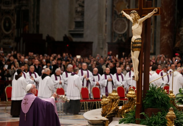 Pope Francis venerates a crucifix during a penance service in St. Peter's Basilica at the Vatican March 4. (CNS/Paul Haring)