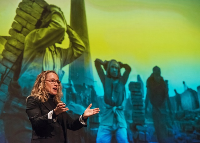 Photographer Lisa Kristine gives a presentation at St. Norbert College in De Pere, Wis., about her work photographing human trafficking around the world. (CNS/Sam Lucero, The Compass)