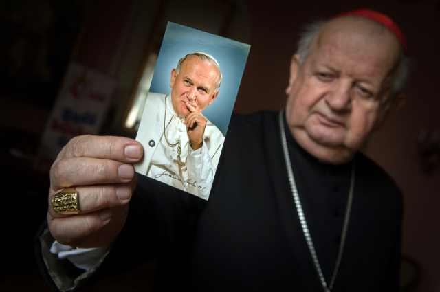 Cardinal Stanislaw Dziwisz of Krakow, Poland, holds a picture of St. John Paul II at his residence in Krakow March 4. Cardinal Dziwisz was the personal secretary of the late pope. (CNS/Marcin Mazur, Bishops' Conference of England and Wales)