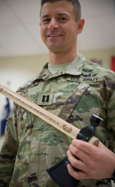 Father Lukasz J. Willenberg holds a specially engraved tomahawk awarded to him for setting a new record for the fastest 12-mile foot march by any soldier to graduate from the U.S. Army's elite DeGlopper Air Assault School. (CNS/Chaz Muth)