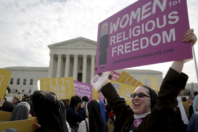 Women religious display signs as they protest the Affordable Care Act's contraceptive mandate March 23 outside the U.S. Supreme Court in Washington. The court heard oral arguments in the Zubik v. Burwell mandate case. (CNS/Reuters)