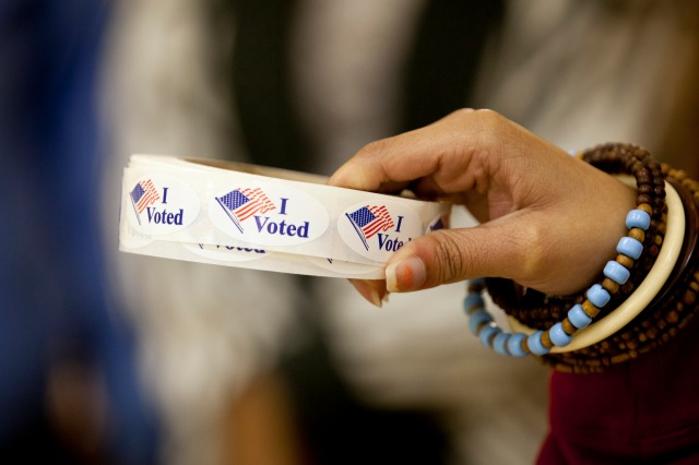 """I voted"" stickers are ready at a polling place in Washington in 2012. (CNS/Nancy Wiechec)"