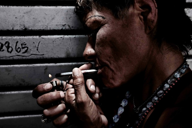 An addict smokes drugs in San Jose, Costa Rica. (CNS/EPA)