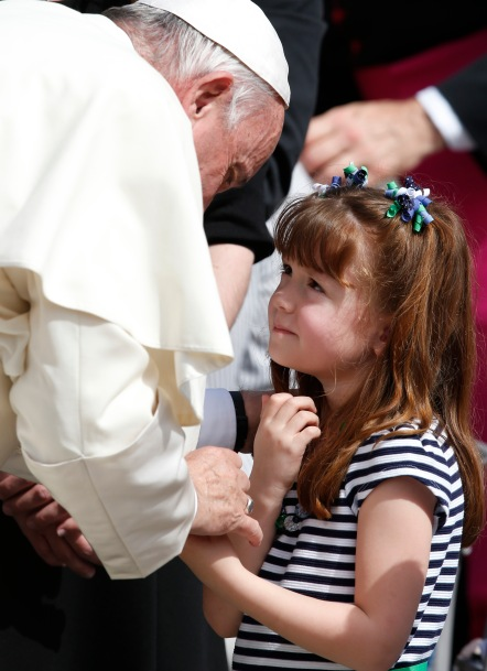 "Pope Francis greets Lizzy Myers of Mansfield, Ohio, during his general audience in St. Peter's Square at the Vatican April 6. Lizzy, who has a disease that is gradually rendering her blind and deaf, met the pope as part of her ""visual bucket list."" (CNS/Paul Haring)"
