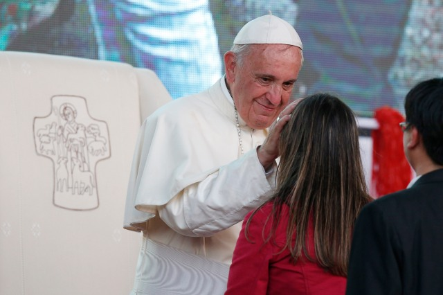 "Pope Francis greets a young woman during a meeting with youths in Asuncion, Paraguay, last summer. Pope Francis' postsynodal apostolic exhortation on the family, ""Amoris Laetitia"" (""The Joy of Love""), was released April 8. It is the concluding document of the 2014 and 2015 synods of bishops on the family. (CNS/Paul Haring)"