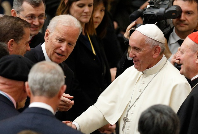 Vice President Joe Biden gestures as he meets Pope Francis after both leaders spoke at a conference on adult stem cell research at the Vatican April 29. (CNS/Paul Haring)