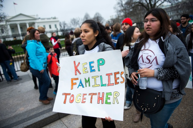 Immigration advocates demonstrate on Pennsylvania Avenue in front of the White House in Washington in 2015. (CNS file/EPA)