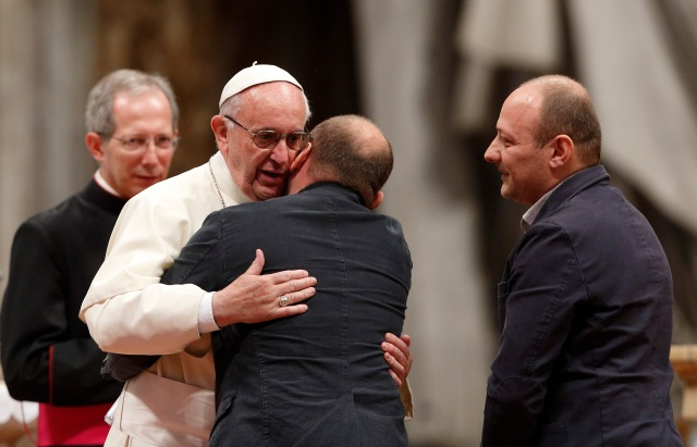 "Pope Francis embraces Maurizio Fratamico, with his twin brother Enzo, during a prayer vigil ""to dry the tears"" of the suffering in St. Peter's Basilica at the Vatican May 5. Maurizio told the story of how both of them found God. (CNS/Paul Haring)"