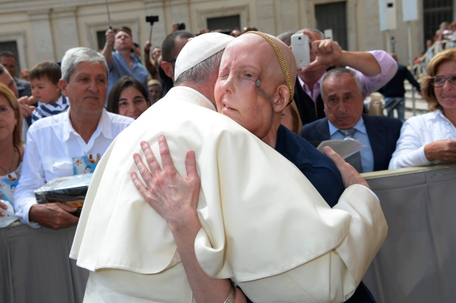 Pope Francis embraces Cheryl Tobin, who has stage IV cancer, during his general audience at the Vatican May 11. Tobin, from Clarksville, Tenn., was visiting Rome to fulfill a dream and to pray for a miracle. Doctors have given her three to nine months to live. (CNS/L'Osservatore Romano)