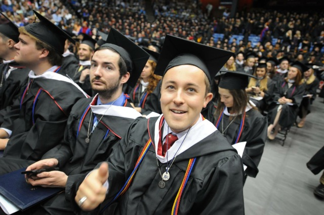 Dominic Sanfilippo, center, during commencement at the University of Dayton, was one of 12 students who graduated with a human rights degree, (CNS/Larry Burgess, University of Dayton)