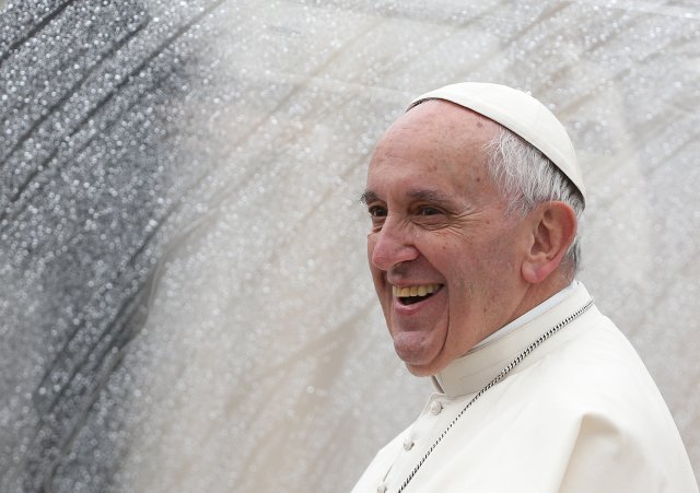 Pope Francis smiles as he leaves at the end of the jubilee audience in St. Peter's Square at the Vatican May 14. (CNS/Reuters)